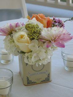 tea tin centerpiece for garden style wedding via floralartvt.com