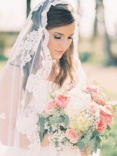 half updo with a mantilla veil for a heavenly look