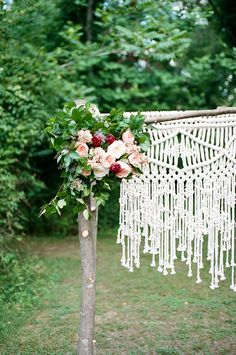 macrame ceremony backdrop, photo by Jeffrey C. Gleason Photography http://ruffledblog.com/natural-romantic-wedding-with-macrame-details #backdrops #diy #ceremonies