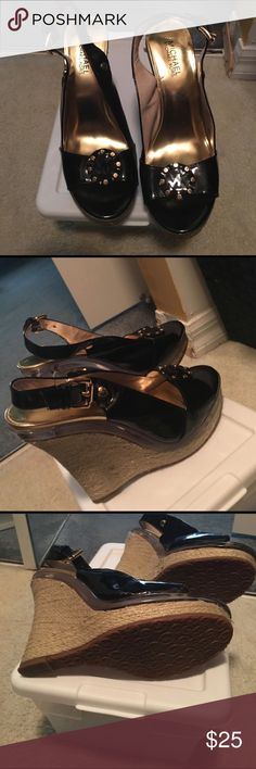 Michael Kors black patent wedges Black patent peep toe. Gold hardware . Like new . Worn once . Very pretty . MK insignia on toe . Michael Kors Shoes Wedges