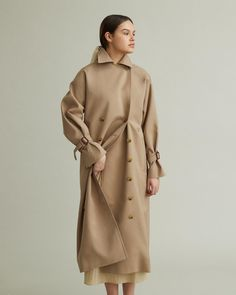 A modern reinterpretation of a classic trenchcoat, cut from a crisp woven cotton featuring oversized lapel collars and front welt pockets. Double Breasted Trench Coat, Fashion Sketchbook, Woven Cotton, Cool Suits, Designing Women, Outerwear Jackets, Crisp, Collars, Apothecary
