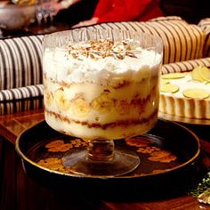 Banana Pudding Trifle ..Down-home comfort takes an upscale spin in this spirited version of banana pudding. Vanilla wafers, laced with bourbon and rum, and crunchy bits of chocolate-covered toffee bars make it too delicious to resist.