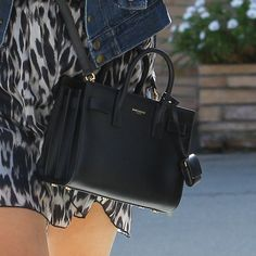 From Reese Witherspoon s baby Sac du Jour bag to Margot Robbie s black  duffle, Yves Saint Laurent handbags continue to be popular with celeb and  fash packs ... a2b298b8c4