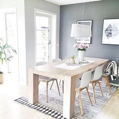 The beautiful dining room of @moniithe  featuring our House Doctor block rug available for pre order @immyandindi