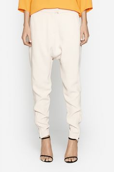 Camilla and Marc | CONIC TROUSER  US$346.07 Timeless trousers designed in a soft pink twill weave featuring a low-crotch and tapered leg. This wardrobe staple includes a waistband and fly front zipper fastening.