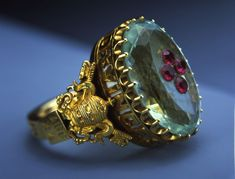 The ring belonging to Pope Pius IX is made of gold, aquamarine and red garnet. It is part of an exhibit of Vatican art treasures on tour in 2004 in the United States. Ancient Jewelry, Antique Jewelry, Vintage Jewelry, Bishop Ring, Jewelry Box, Jewelry Rings, Gold Rings, Gemstone Rings, Royal Jewels