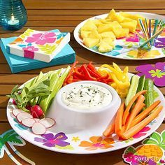 Bright veggies and fruits make for tasty app displays your guests will dive right into! Our hibiscus patterned trays, plates and matching napkins combine for a pretty party look.