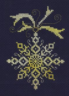 Simple snowflake design (World of Cross stitch?) but when worked in variegated thread on navy aida takes no a new look.  Very pleased with results