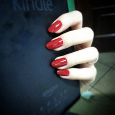 Oval red nails.