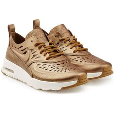 Nike Gold Leather Air Max Thea Joli Sneaker ($115) ❤ liked on Polyvore featuring shoes, sneakers, gold, nike trainers, lace up shoes, nike, leather lace up sneakers and nike shoes