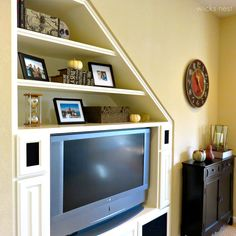 Under stairs tv unit under trappa pinterest stairs for Tv showcase designs under staircase