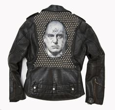 Aleister Crowley Leather Jacket by Matt Momchilov. Charcoal, acrylic, and 355 metal studs on vintage leather jacket. 2011.