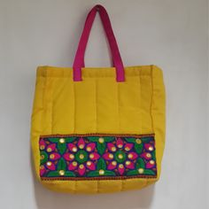 Beautiful ethnic mirror work handmade quilted bag ideal for gifting on festive season.