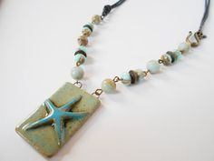 turquoise starfish pendant necklace ceramic pendant by jcudesigns
