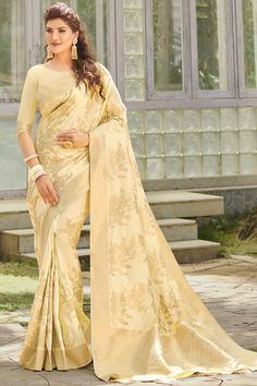 Cream banarasi silk saree with cream silk blouse, embellished with woven zari. Saree with Round Neck, Elbow Sleeve. It comes with unstitch blouse, it can be stitched 32 to 58 sizes. #cream #banarasi silk #saree #blouse #indiansaree # #Andaazfashion #UK