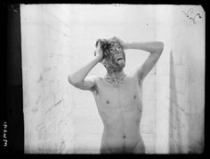 Miner taking a shower, Askern Colliery, South Yorkshire, 18 January 1944.