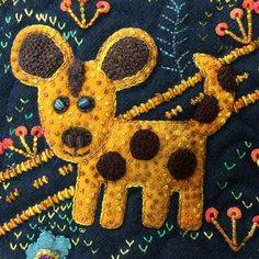 Did you know Sue stitched an animal that represented each of her four kids into her Folk-Tails quilt? This wild dog here is Jason! #suespargo #creativestitching #creativetexturing #folktails #handdyedwool #handdyed #wilddog #africa #embroidery #embroideryinstaguild #eleganza