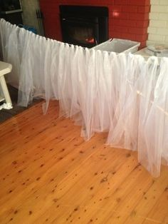 DIY bridal Table skirting for $12 with string/rope/fishing line and tulle. GREAT IDEA!! Pretty with just white, or white tulle over colored linen. by jan