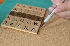 Scrabble tile coasters. Use as name place things for a function or just for fun around the house. 25 scrabble tiles per coaster, cork board, knife, glue, and varnish :)