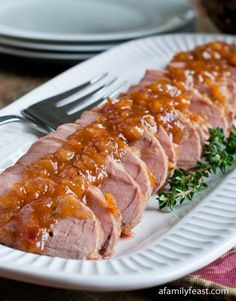 A simple and delicious recipe for Sweet and Sour Glazed Pork Tenderloin - http://www.afamilyfeast.com