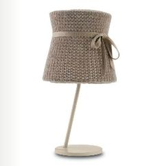 The lovely Miss Wool knitted lamp, with that charmingly feminine bow, is from Italian design company Doimo Decor.