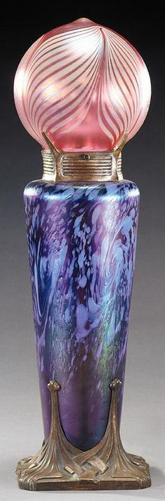 """GUSTAV GURSCHNER Loetz-style iridescent glass base, swirled blue spots on purple, deeply patterned bronze base and top mounts, base inscribed """"Gurschner Depose"""", frosted cranberry globe with iridescent feather overlay, rim ground and drilled to fit, probably a replacement, 17-1/2 x 5"""" 