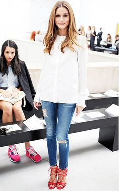 Olivia Palermo perfects the dressy blouse and denim ensemble.