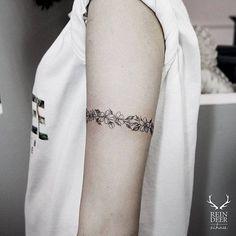 Floral armband tattoo.