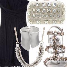 Outfit per la sera, composto da abito senza spalline e con dettagli in pizzo color navy e accessori ovviamente argento. Per uno stile sensuale, al passo con i tempi e che non vi farà passare inosservate.