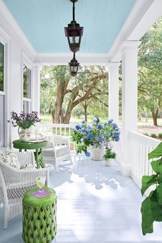 "I love the ""Haint Blue"" painted porch cieling. A Charming Southern Cottage – Blue and White Home Veranda Design, Farmhouse Front Porches, Southern Front Porches, Rustic Farmhouse, Painted Front Porches, Cottage Farmhouse, Farmhouse Ideas, Farmhouse Style, Outdoor Rooms"