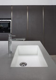 Sink & tap surrounded with Dove grey Corian.