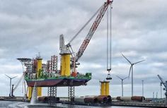 The windfarm installation vessel INNOVATION loading in the port of Eemshaven (Netherlands).