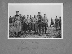 British and German soldiers share a friendly photographic opportunity during the 1914 Christmas Truce. From an album of 84 photographs compiled by Lieutenant Colonel A F Logan MC, East Surrey Regiment...