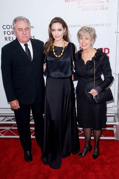 Angelina Jolie walks red carpet with Brad Pitts parents at Blood and Honey premiere