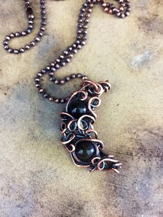 A personal favorite from my Etsy shop https://www.etsy.com/listing/523350629/black-obsidian-crescent-moon-pendant