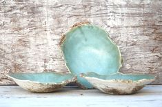 The Oyster series.  Individually so each is one of a kind. Rough on the bottom and smooth on the inside. Great large entree bowls for pasta, salads and gumbo!.