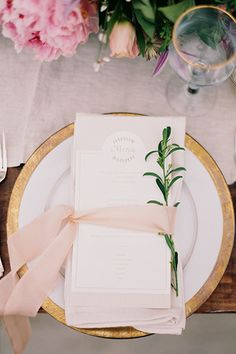 A table setting can consist of much more than dinnerware and linens. Spruce them up with accents, such as a pale blush ribbon and trim of…