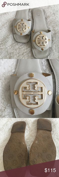 Tory Burch leather sandals A great pair of Tory Burch white pebble leather slip on sandals. gently worn   Beautiful white enamel logo and goldtone hardware Tory Burch Shoes Sandals