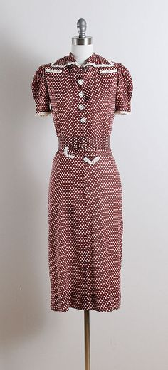 ➳ vintage 1940s dress * brown and white semi-sheer cotton * polka dot print * puffy sleeves * nautical buttons * detachable belt * not side or back closure - goes on over head condition | excellent fits like xs/s dress length 43 bodice 15 bust 34 waist 28-30 hips 36-37 belt 27 ➳ shop http://www.etsy.com/shop/millstreetvintage?ref=si_shop ➳ shop policies http://www.etsy.com/shop/millstreetvintage/policy twitter | MillStVintage facebook | millstreetvintage instagram | millstreetvintage x...