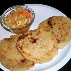 Pupusas de Queso (Cheese-Stuffed Tortillas) Recipe - my neighbor made these for us. especially fabulous with the curtido, which is onion, coleslaw, carrots and vinegar (think there& a bit of sugar she throws in too--not much). Pupusa Recipe, Pupusas Recipe Cheese, Recetas Salvadorenas, Queso Cheese, Tortilla Recipe, Mexican Food Recipes, Ethnic Recipes, Homemade Tortillas, Queso Fresco