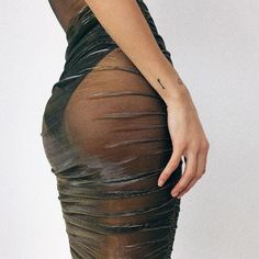 Would i dare!?! I would love to strutt my stuff on this cool bodysuit and skirt!