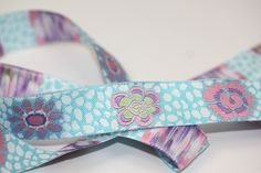 "Crafters Vision - DR - Kaffe Fasset - Aqua and White Guinea Flower Ribbon 7/8"", $3.74 (http://www.craftersvision.com/dr-kaffe-fasset-aqua-and-white-guinea-flower-ribbon-7-8/)"