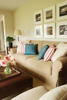 photos behind the couch - family room