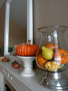 Gourds in a large apothecary jar for decor