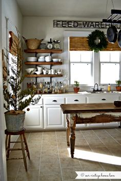 same kitchen before cabinets and counter top were painted via our vintage home love: Christmas Sneak Peek