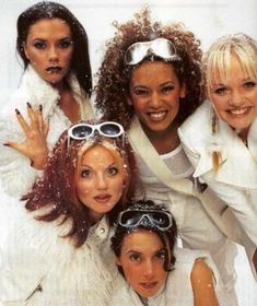 Victoria's hand in their Christmas photoshoot.   43 Reasons Why The Spice Girls Are The Best Girl Group Of All Time