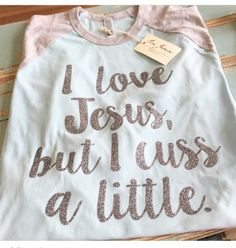 Silver glitter design on pale blue raglan with gray sleeves. Super cute colors. Made with heat transfer vinyl and pressed on with heat press. These