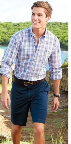 spring/summer. light plaid shirt. brown belt. navy blue shorts. sperrys or vans. cool. comfortable. style.