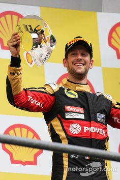 Romain Grosjean, Lotus F1 Team celebrates his third position on the podium in Spa 2015