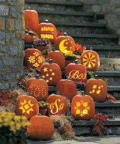 So many fun pumpkin carving ideas. They look so great all together on the steps.